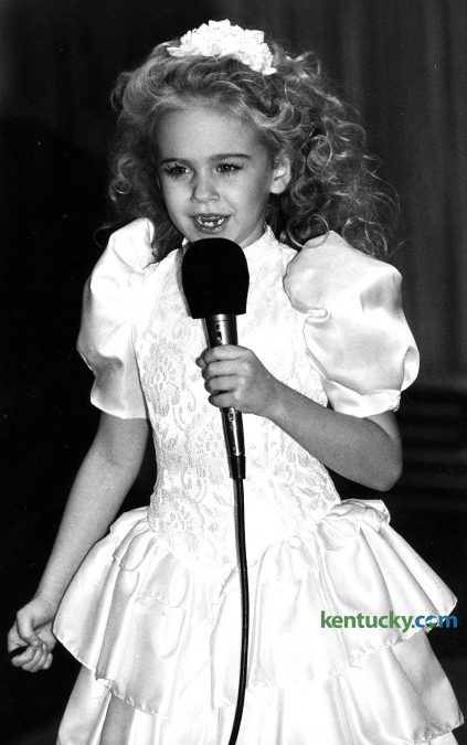 "Six-year-old Laura Bell Bundy sings ""My Old Kentucky Home"" at the beginning of Leukemia Society benefit and fashion show Jan. 23, 1988 in Lexington. Bundy, a Lexington native, is a singer and actress who has performed on Broadway, TV and movies. On Broadway, she is best known for her Tony Award-nominated performance as Elle Woods in the musical version of ""Legally Blonde"" and originating the role of Amber Von Tussle in ""Hairspray."" On TV she has played opposite  Charlie Sheen on ""Anger Management"" on the CW's ""Hart of Dixie"" and had many guest appearances in shows from ""Home Improvement"" to ""How I Met Your Mother."" She has also produced several successful web sketch comedy series. Bundy has appeared in such movies as ""Jumanji"" and ""Dreamgirls."" She has also released five country music albums, the most recent in June 2015. Bundy is set to star as Trixie in an all new Broadway musical version of The Honeymooners alongside Hank Azaria, Leslie Kritzer and Michael McGrath. Photo by Alan Lessig"