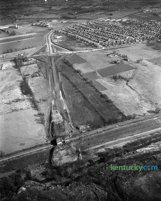 Construction of New Circle Road at the intersection of Leestown Road, November 1960. Town Branch runs along the bottom of the photo and the Meadowthorpe neighborhood is seen at the top right. The area in the middle on the right side is now a number of hotels, stores townhomes and restaurants such as Applebee's, Zaxby's and Taco Bell. Further to the right of that is the Meadowthorpe Shopping Center which includes a Kroger grocery store. On the far left in the middle, is what us now Leestown Middle School. Herald-Leader Archive Photo