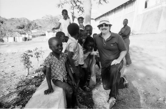 Lexington Leader columnist Don Edwards posed with a group of kids in Ranquitte, Haiti in April 1982. Edwards and Herald-Leader photographer Ron Garrison accompanied a Christian Flights International missionary group from Kentucky who operated a medical and dental clinic in the village. Edwards, who retired in 2001 chronicled life in the Bluegrass with passion, wit and humor for 22 years, died early Tuesday July 26, 2016. He was 75. Photo by Ron Garrison | Staff
