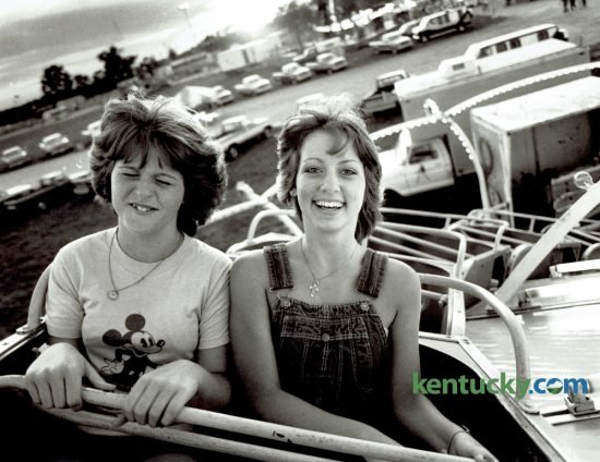 Cousins Shelia Shadoan, left, and Terri Shadoan reacted to one of the midway rides on the opening day of the Lion's Blue Grass Fair at Masterson Station Park June 14, 1982. This year's fair opens today at Masterson Station Park. Photo by Charles Bertram | Staff