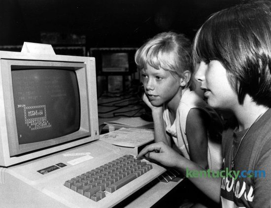 Nine-year-old Lisa Sherrod, left, and 11-year-old Kirby Varney work on an Apple IIe computer during a summer computer camp at Shearer Elementary School in Winchester, July 16, 1985. During the camp, students got lessons in computer history, computer literacy and typing skills and how to create and save programs. After the technical things were learned, the students turned to more fun things. They drew pictures on the computer screens. Some were very simple, such as an American flag or a computer, but others were more detailed, such as a picture of Jetfire, one of the Transformer toys. Photo by John C. Wyatt | staff