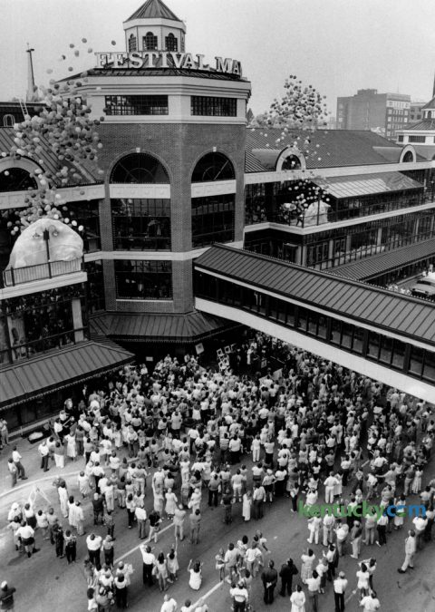 A large crowd was on hand as hundreds of balloons were released to signal the grand opening the Festival Market on July 25, 1986. The grand opening for $16 million development at West Main Street and North Broadway kicked off 10 days of festivities that allowed the public to become acquainted with the shops and restaurants located inside the 3-story marketplace. About 42 of the market's 72 shops and restaurants were open. The development failed to generate sustained profit and the complex was sold for $600,000 in 1994 in an auction. Festival Market was rebranded in 1999 as Triangle Center, consisting primarily of offices with a few retail and restaurant entries. It has since been renamed as The Square. Photo by Frank Anderson | Staff