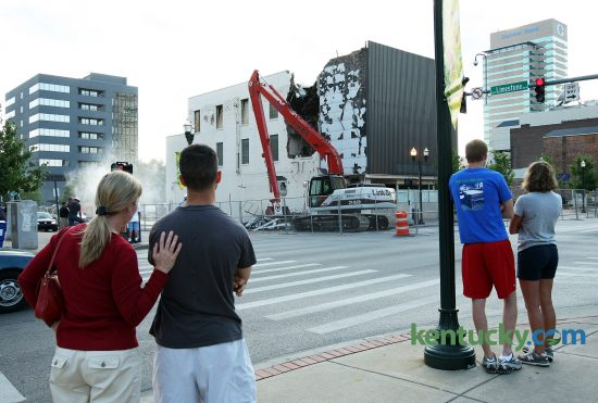 Mary Beth Navmann and Kevin Compton, left, and Brent Roach and Elizabeth Browning, watch members of the Diversified Demolition crew tear down the old Rite Aid building at the corner of Limestone and Main Street in Lexington July 23, 2008. The building was being demolished to make way for the proposed CentrePointe development. Photo by David Stephenson | Staff