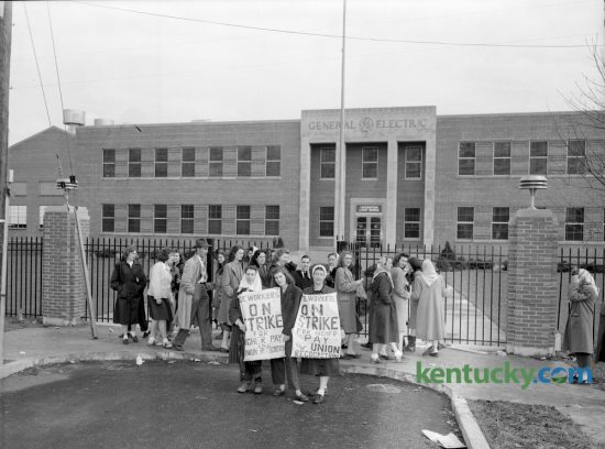 "Some of the more than 100 female protesters took their position in front of the General Electric Company Lamp plant on Rosemont Garden on the morning of March 23, 1948. The United Electrical, Radio and Machine Workers union pulled its members from the Lexington lamp plant on a ""surprise"" work stoppage about  6am. The strike was called because of the company's stalling tactics in talks concerning U.E. recognition as the sole bargaining agent at the plant. Six U.E. members were arrested for blocking an entrance to the plant. General Electric Lighting announced Friday it will close two plants in Kentucky, one in Somerset and the Lexington plant by August 2017. Published in the Lexington Leader March 23, 1948. Herald-Leader Archive Photo"