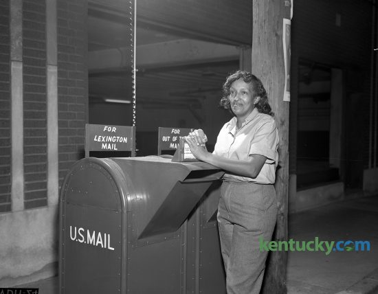 Ruby Flynn, 412 Price Road, was named substitute city letter carrier for the Lexington Post Office becoming the city's first peace time woman mail carrier in October 1963. Postmaster William Cecil said that all carriers begin as substitutes and generally serve on different routes before being assigned to a regular one. Mrs. Flynn, mother of six children, did civilian work with the Navy Department during World War II. Published in the Lexington Leader October 3, 1963.