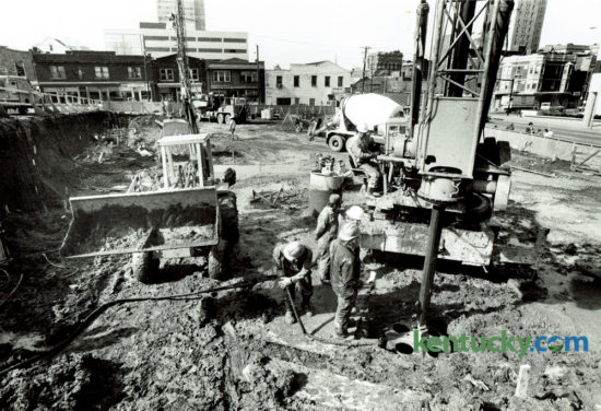 Workers with McKinney Drilling Company, Louisville, used a foundation drill to create holes that would be filled with concrete for the support piers for an eight story office building at the corner of Vine Street and Limestone on March 11, 1980. Webb Properties was the building developer and White and Congleton was the general contractor. The office building now houses Community Trust Bank and Investment Company. Photo by David Perry | Staff