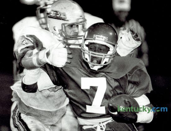 Lafayette High School quarterback Matthew Gay (7) fought off the grasp of a Boone County tackler on November 15, 1985. Lafayette downed the Rebels 34-7. The Generals kick off their season tonight, meeting Paul Laurence Dunbar in a neutral site at Scott County. Photo by David Perry | Staff