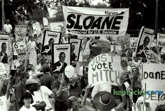 Attendees at the 110th annual Fancy Farm political picnic on August 4, 1990, at St. Jerome Catholic Church in western Kentucky displayed their support for a variety of candidates, including Harvey Sloane, a democrat running for the U.S. Senate against incumbent senator Mitch McConnell. McConnell won a tough campaign against the former Louisville mayor by 4.4%. The 2016 Fancy Farm picnic gets underway this morning. Photo by Charles Bertram | Staff