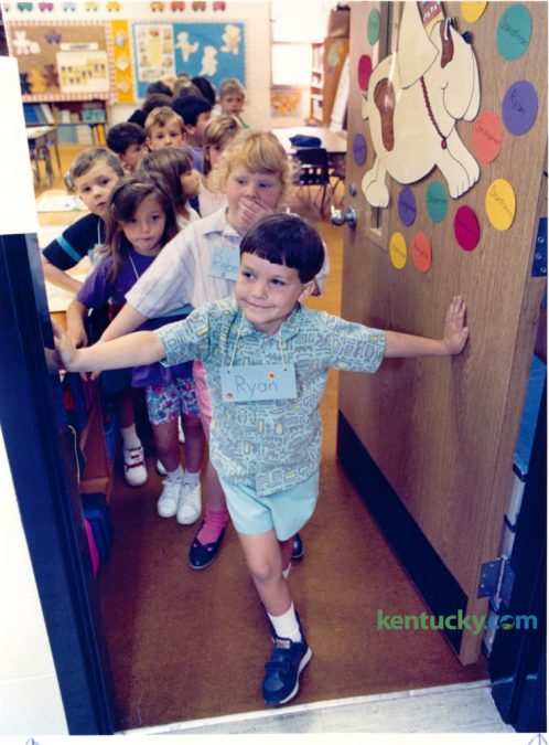 Ryan Cook, 6, a first grader at Mill Creek Elementary School waited along with his classmates to go outside for recess on the first day of school August 22, 1991. Today is the first day of school for Fayette County. Photo by Ron Garrison | Staff