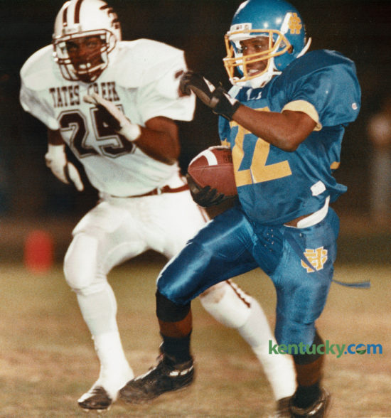 Henry Clay's Shawn Redmond (22) picked up 44 yards in the second quarter as Tates Creek's Kevin Jackson gave chase as the two city schools met on October 15, 1993 at Henry Clay High School. Henry Clay came out on top 14-7, thanks to a stingy defense. The Blue Devils take on Ryle High School in the Bluegrass Bowl tonight at Lexington Catholic. Photo by Janet Worne