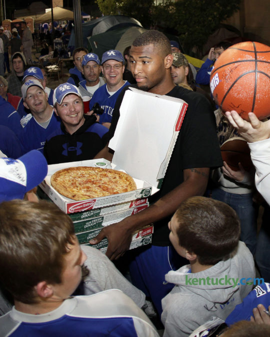 Kentucky basketball player DeMarcus Cousins called out with pizza as UK players served pizza and signed autographs and coach John Calipari signed for fans who were camping out for Midnight Madness on Friday October 2, 2009 in Lexington. The team frequently brings campers pizza during their stay on the grounds outside Memorial Coliseum. This years campout for Big Blue Madness tickets starts at 5 a.m. Wednesday and ends when tickets are distributed at 10 p.m. Friday. Photo by Mark Cornelison | Staff