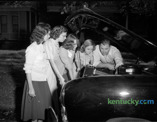 Lexington patrolman William Sellers gave some Henry Clay High School students pointers in preparation for a driving class, September, 1948. The classes were sponsored by the Bluegrass Automobile Association and the Lexington police department. From left are Bobby Cain, Pearl Woolery, Betty Smith Jo Ann Robinson and partolman Sellers. About 40 students took the course. Published in the Lexington Leader September 17, 1948. Herald-Leader Archive Photo