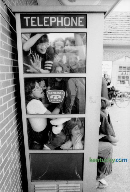 In what was described as an experiment,  a group of Tates Creek Junior High School students decided to see how many people they could fit inside a  phone booth. The result of their experiment resulted in 13 students inside the phone booth, which was at the Lansdowne Shopping Center on Tates Creek Road. Those students that made it inside included, in no particular order, Kathy Borkowski, Mary Beth deCastro, Brawn Sharp, Kelly Hayworth, Brian Sams, Tim Esenbock, Donna Lawson, Jay Rice, Kathy Frank, Karen Linville, Greg LaRue, Neil Welllinghurst and Mark Curry. Photo by Ron Garrison | Staff