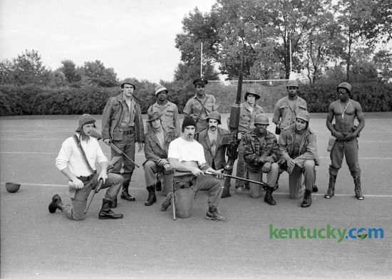 The defensive unit of the 1975 University of Kentucky football team called themselves The Dirty Dozen, in reference to a movie about a daring raid behind enemy lines in World War II, staring Lee Marvin and former Cleveland Browns great Jim Brown. In early October the unit, then ranked number 8 in the nation defensively, decided to pose for a photo in military gear, with the help of J&H Army Surplus. Front row kneeling, from left, Rick Fromm, Bob Winkel, Mike Emanuel, Tom Ranieri, Jerry Blanton, Art Still. Standing, from left, Jim Kovach, Ray Carr, Tony Gray, Mike Siganos, Terry Haynes, Greg Woods. Photo by David Perry | Staff