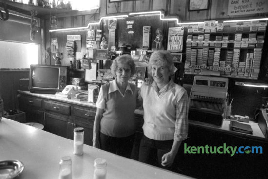 "Virginia ""Mom"" Haycraft, left,  and Lorraine Taylor, behind the bar at the Green Lantern Restaurant at East Seventh Street and Elm Tree Lane in January 1979. Haycraft owned and operated the restaurant since 1940 and Taylor had worked there for 30 years. The Green Lantern became a popular hang out with Transylvania University students starting in 1960. Published in the Lexington Herald-Leader January 17, 1979. Photo by Ron Garrison"