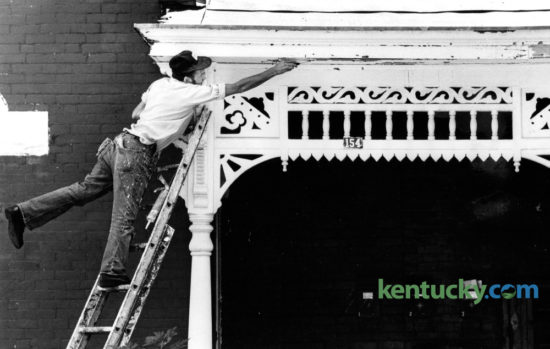 Cloyd Standafer, with C&S Painting, scraped loose paint from the porch of a house at 154 Kentucky Avenue on September 29, 1980. Photo by Charles Bertram | Staff