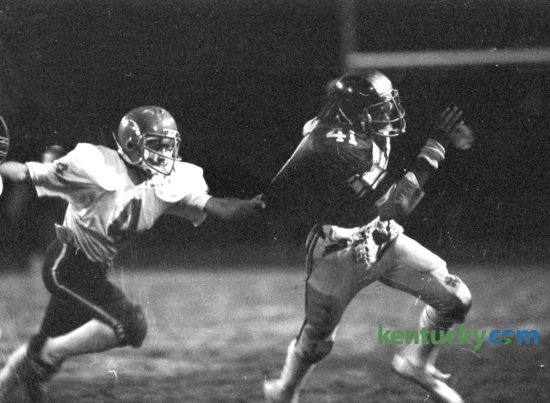 Henry Clay's Robert Wakefield, right, tried to elude the grasp of Lafayette defender Paul Vines in their game October 30, 1981 at Henry Clay. The Blue Devils won 31-6 and went on to claim the school's only state football title that year. This years squard takes on No. 7 Lafayette tonight. Photo by Charles Bertram | Staff