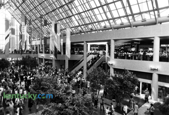 The atrium of Louisville's Galleria, opening day, Sept. 29, 1982. The $130 million development included more than 1.4 million square feet of office space, anchored by two 27-story glass and steel office buildings containing 415,000 square feet each. A three-level retail mall will 339,000 square feet was located between the towers. The development covered much of the two square blocks downtown bounded by Fourth Avenue, Liberty Street, Fifth Street and Muhammad Ali Boulevard. It was built on the site of the River City Mall, which opened in 1973. On this day When the Galleria opened, about 75 percent of the retail space had been leased. In 2004, the retail part of the development went through a $75 million renovation featuring a collection of bars, restaurants and stores now called Fourth Street Live. Photo by Charles Bertram | staff