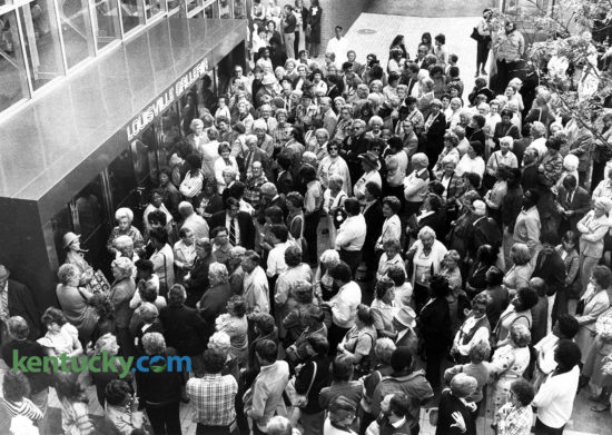 People wait on Fourth Avenue for the opening of the downtown Louisville shopping mall. An estimated 18,000 people were on hand for the opening cermony at 9:30 a.m. and the total had reached 25,000 by 11 a.m. Photo by Charles Bertram | staff