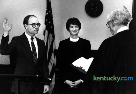 Ray Larson is sworn in as the new Fayette County commonwealth attorney, Jan. 2, 1984 by Judge L.T. Grant as Larson's wife, Betty, looks on. Larson was appointed by Gov. Martha Layne Collins to succeed Larry Roberts, who had been commonwealth's attorney for seven years and who announced in November 1984 that he was resigning to enter private practice. In the brief swearing-in ceremony in front of an overflow crowd of about 175 people at the Fayette County Courthouse, Larson, 40, said he looked forward to the challenge of trying to maintain the level of professionalism for which, he said, Roberts' office had become known. Almost 32 years later, Larson announced Sept. 9, 2016 that he is retiring as Fayette County's longtime chief prosecutor. Photo by Tom Woods | staff