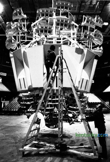 Lexington Center employee Craig King held the ladder for Bob Stoops as he checked the speakers on 'Big Bertha' on March 18, 1985. The speaker cluster had been dropped to the Rupp Arena floor for a complete cleaning prior to the NCAA Final Four tournament later that month.