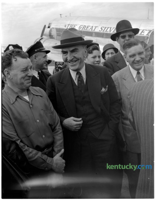 Captain Eddie Rickenbacker, center, World War I ace and president of Eastern Airlines, was on hand at the dedication of Bluegrass Field in 1946. Captain Rickenbacker attended the CAP-AFF Air Show in association with the unveiling of the T. Ward Havely Memorial. Rickenbacker was an American fighter ace in World War I and Medal of Honor recipient. With 26 aerial victories, he was America's most successful fighter ace in the war. He was also a race car driver and automotive designer, a government consultant in military matters and a pioneer in air transportation, particularly as the longtime head of Eastern Air Lines. Published in the Lexington Herald-Leader November 10, 1946. Herald-Leader Archive Photo