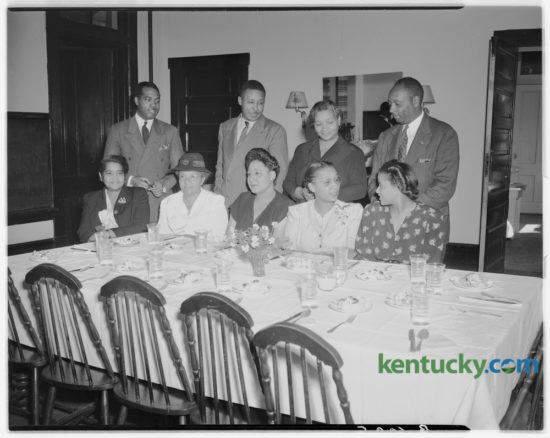 Section chairmen and team captains of the colored solicitation division of the Community Chest campaign met at the Phyllis Wheatley YWCA to work out details of the drive, which extends from October 27 to November 7, 1947. Pictured left to right at the luncheon meeting are, first row, Mrs. Lucy Hart Smith, chairman, special gifts committee; Mrs. Lydia Searcy, captain, Coletown; Ethel Taylor, co-chairman; Mrs. Shirley Hardy, captain, West End; Mrs. Lizzie Johnson, YWCA executive; standing, U.S. Fowler, division chairman; A.R. Howard, captain central district; Mrs. Elizabeth Moody, assistant captain, and Clifton Coleman, captain, South End. Published in the Lexington Herald-Leader October 26, 1947. Herald-Leader Archive Photo