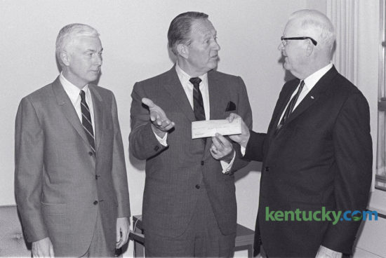 Art Linkletter, center, author and TV personality, presented a check for $250 to Fred Bryant, right, chairman of the board of Shriners Hospital for Crippled Childrena At left is William T. Young, Lexington businessman and chairman of the board of directors of Royal Crown Cola, which sponsored Linkletter's visit. Linkletter, a member of the board of Royal Crown Cola was in Lexington for two speaking engagements January 15, 1968. Herald-Leader Archive Photo