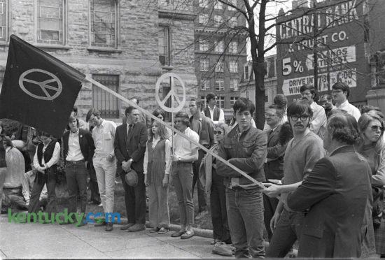 About 100 University of Kentucky students joined the Lexington Peace Council for a silent demonstration April 15, 1970 in front of the Fayette County Courthouse to protest the Vietnam War. Photo by Frank Anderson | Staff