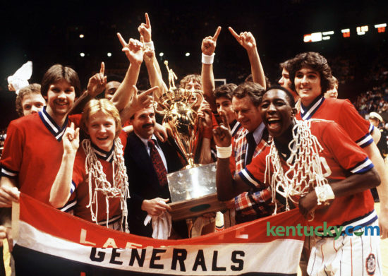 "The Lafayette Generals basketball team celebrate after winning the Boys' Sweet 16 championship, March 17, 1979 in Rupp Arena. Dirk Minniefield, who was named Mr. Basketball that year, is front right with the net around his neck. Assistant coach Donnie Harville and head coach Charles ""Jock"" Sutherland, right, hold the trophy. On Oct. 23, 2016, Sutherland was named to the Kentucky High School Athletic Association 2017 Hall of Fame class, along with 10 others. Photo by Ron Garrison 