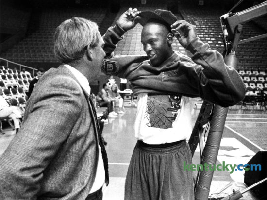 "University of Kentucky Athletics Director C.M. Newton, left, talked with NBA star Michael Jordan after the Bulls' practice before Chicago's exhibition game, Oct. 15, 1991 at Rupp Arena. A crowd of 20,775, more than double the largest to see a pro game in Lexington, saw Jordan score 20 points in his 22 minutes during the 98-83 win over the Seattle SuperSonics. For all the promise of flying jams and unreal moves to the basket, the moment crystallized on two Jordan free throws (of all things). With 6:04 remaining in the third quarter, Jordan stepped to the line. Flash bulbs accompanied each free throw. A strobe-like effect befitting a rock concert prompted a smiling Jordan to back away from the line. The first for Rupp was old news for Jordan. ""I've done it quite a few times,"" he said of the blinding free throws. ""It's not new to me. But everybody got a kick out of it."" The crowd got two patented Jordan dunks -- a fast-break stuff early in the first quarter and a leaning right-handed slam in the third. That season, Jordan would go on to lead the Bulls to their second of three consecutive NBA titles. Photo by David Perry 