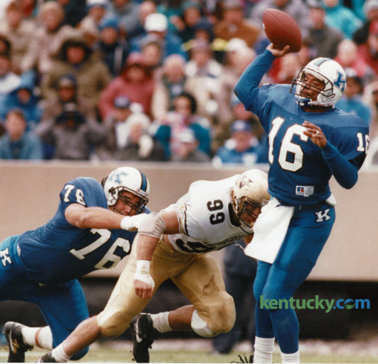 Vandy's Tony Cates got by Kentucky tackle Mark Askin but didn't get to quarterback Pookie Jones before he got the pass off in the Wildcats 20-7 loss at Commonwealth Stadium November 7, 1992. UK went 4 for 7 on the season under coach Bill Curry. Photo by David Perry | Staff