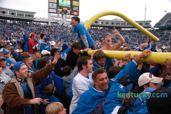 Wildcat fans carried the goal post around the field after it was torn down following the University of Kentucky's upset of Georgia on Saturday November 4, 2006 at Commonwealth Stadium.  Kentucky marched on an 11-play, 69-yard drive for a go-ahead touchdown with 1:21 remaining and then got a game-clinching interception from Trevard Lindley to post a historic 24-20 win over Georgia. It was UK's first win over Georgia since 1996 and sent the Commonwealth Stadium crowd of 62,120 into a post-game, goal post-tearing frenzy. David Perry |Staff