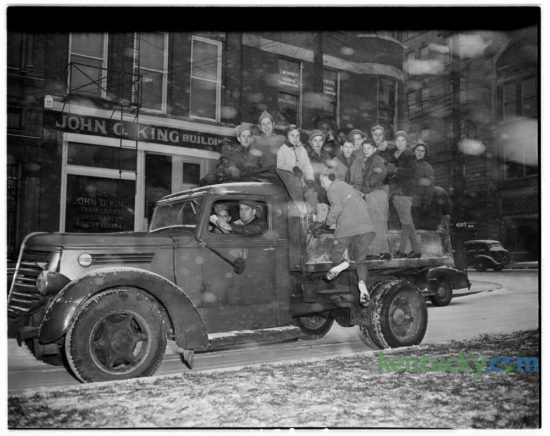 Lexington Boy Scouts collected donated toys in below-freezing weather and falling snow on Nov. 23, 1945. The Scouts planned to repair and redistribute the toys. Published in the Lexington Leader. Herald-Leader Archive Photo