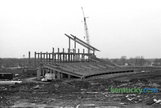 Construction on what would become Commonwealth Stadium, home for University of Kentucky football games, as seen in mid December 1972. When construction was completed in 1973, Commonwealth Stadium had a capacity of 57,800. It was built  at a cost of $12 million by the firm of Huber, Hunt, and Nichols. The stadium and parking areas rest on an 86-acre plot that was once part of the UK Experimental Station Farm Grounds. The stadium was officially opened on Sept. 15, 1973, as the Wildcats moved into their new home after spending 48 years at Stoll Field/McLean Stadium across from Memorial Coliseum. Kentucky defeated Virginia Tech in the stadium opener, 31-26, as quarterback Ernie Lewis ran for two touchdowns and threw for another TD to lead the Wildcats. Published in the Lexington Herald December 14, 1972. Herald-Leader Archive Photo