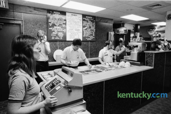 Lexington's second LaRosa's Restaurant location opened in the Coliseum Plaza, corner of Rose Street and Euclid Avenue in early February 1975. The popular Cincinnati-based restaurant featured big backed booths and stucco walls. Preparing to serve customers were, from left, Diana Cagle, Jim Hoff, manager, Lance Churchill, co-owner, and Kirk Seeberger, co-owner. The first Lexington LaRosa's location opened in Woodhill Shopping center in 1974. Both locations were closed before 1979.  Photo by Frank Anderson | Staff