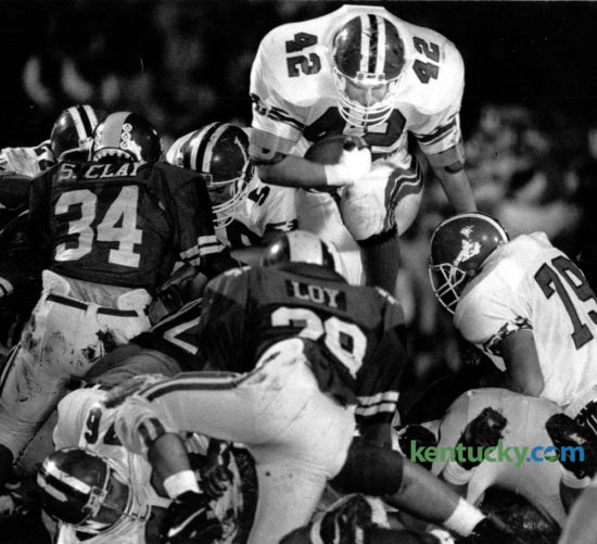 Lafayette's Bert Hooper (42) dove over the Henry Clay line to pick up short yardage during first quarter action on November 1, 1991. Lafayette came out on top with a 24-16 victory at Heber Field. The Generals play Scott County tonight in state semi-final action at Lafayette. Photo by Tim Sharp | Staff