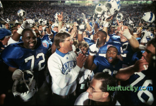 University of Kentucky football coach Bill Curry celebrated with his team after they defeated the University of Louisville 20-14 in the first meeting of the two teams in 70 years on September 3, 1994 in Commonwealth Stadium. The all-time rilvary is tied at 14-14, although Louisville leads the modern series 14-8. The Wildcats and the Cards meet today at noon at Papa John Stadium in Louisville. Photo by Charles Bertam | Staff