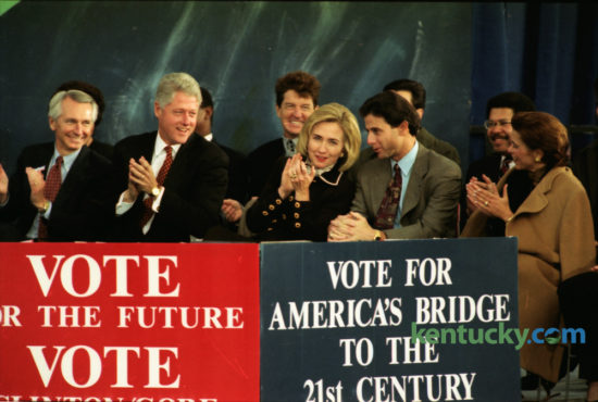 President Bill Clinton and first lady Hillary Clinton talked with Kentucky basketball coach Rick Pitino and his wife Joanne on the speaker's stage at UK November 4, 1996. On Election Eve, Clinton finished months of campaigning with a high-energy pep rally on the UK campus in front of about 14,000 supporters. Kentucky was one of a handful of states where polls showed Clinton running neck and neck with Republican nominee Bob Dole. Clinton won the election with 49.2 percent of the popular vote to Dole's 40.7 and Ross Perot's 8.4. Clinton also carried Kentucky. Photo by Frank Anderson | Staff