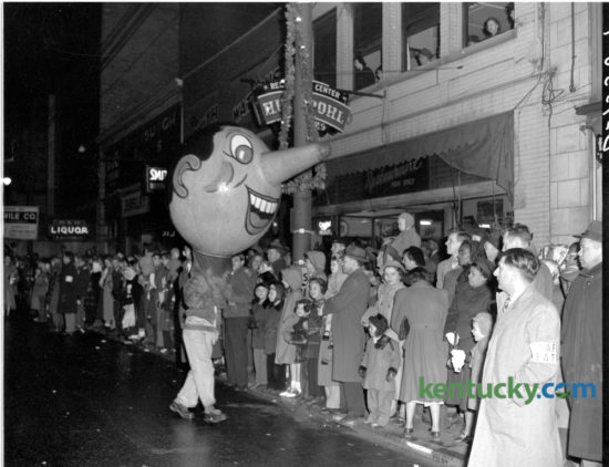 The Lexington Herald reported that 100,000 people braved a cold rainy night on December 1, 1949 to watch the downtown Christmas Parade. Police reported that the parade route from Third and Midland through Main Street to West Second and Broadway was packed solid. This year's Christmas Parade will be held downtown tonight starting at 7pm. Herald-Leader Archive Photo