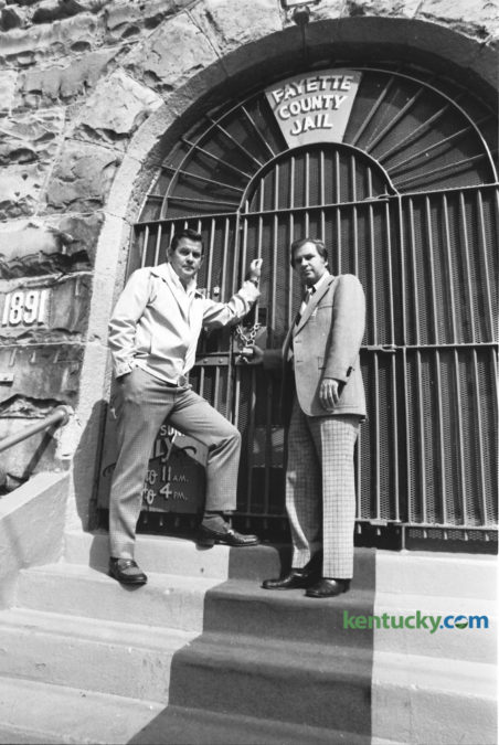 Fayette County Attorney E. Lawson King, left, and Jailer Harold Buchignani, locked up the old Fayette County Jail, built in 1891, on Short Street on October 10, 1976.  One hundred and twenty-four prisoners were transported from this old jail on Saturday October 9, to the new $6.4 million Fayette County Detention Center on Corral St.  By 1989 the new facility, designed to hold 574 inmates was consistently over-populated and a federal judge ordered the city to fix the problem. The current jail, off Old Frankfort Pike, was the solution and was completed in 2000. The $62 million facility was capable of holding 1,200. On October 21, 2000 450 inmates were moved from the downtown jail to the new one on Old Frankfort Pike. Photo by Ron Garrison | Staff