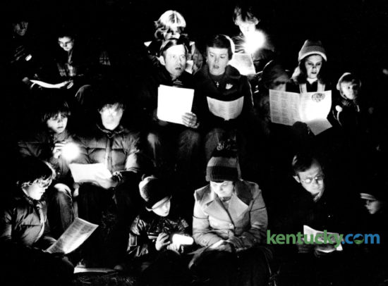 Members of Gethsemane Lutheran Church sang carols during the church's annual Christmas in a Barn service December 20, 1979. The service of prayer, song and communion was held in a barn off Bowman's Mill Road. Flashlights provided the only light for the service. Photo by Ron Garrison | Staff