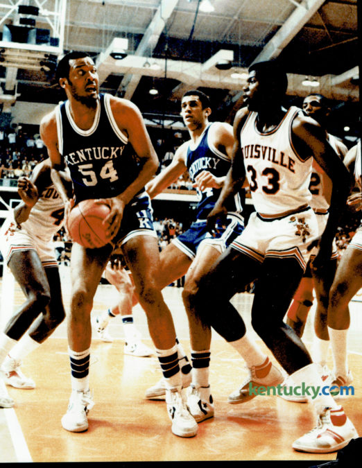 """University of Kentucky's Melvin Turpin, left, who totaled 18 points and a game high 9 rebounds, looked to fake University of Louisville's center Charles Jones during the first """"Dream Game"""" in recent history, between the two schools, at the NCAA Mideast Regional in Knoxville, March 26, 1983. The Wildcats fell 80-68, after being outscored 18-6 in overtime. Photo by Charles Bertram 