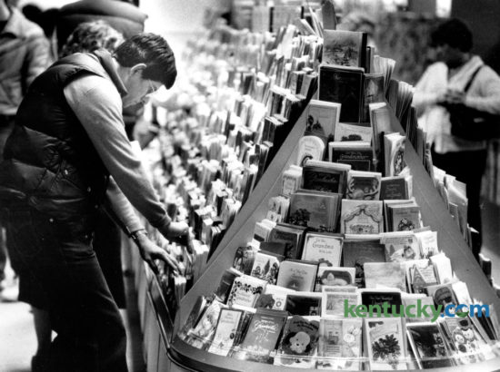 Robert Nave of Lexington was taking his time while trying to pick out a Christmas card at Cards N' Such at Fayette Mall on December 14, 1983. The busiest mailing and shipping day of the year will be tomorrow, Monday December 19. Photo by David Perry | Staff