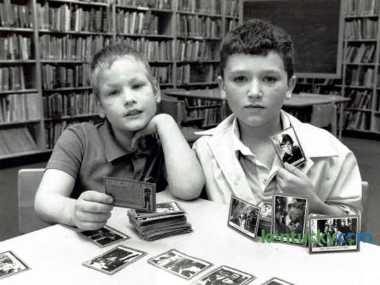 """Soon to be fourth graders, Jason DeNoyelles, left, and Damion Reid with their collection of Return of the Jedi cards at Ashland Elementary School on May 15, 1984. DeNoyelles had been collecting for about two years and had about 100 cards. Reid had 185 cards and started collecting a year before when he lived in New York. He had been trying to find a Death Star card and had bought several packages of cards, but that particular one has not been in them.    He said he planned to keep the cards. """"When I'm about 20 they'll be worth a lot,"""" he said. The latest installment of the Star Wars series, """"Rogue One"""", opens in Lexington theaters tonight. Photo by John C. Wyatt 