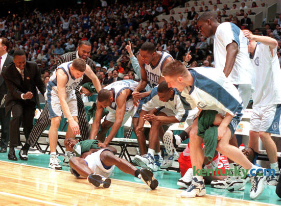 "Tony Delk, lying on the floor, is mobbed by teammates after he was fouled while hitting a 3-pointer during Kentucky's 76-67 win over Syracuse in the NCAA championship game, April 1, 1996 in East Rutherford, N.J. Leading the Cats to their sixth national title, Delk tied a championship-game record with seven 3-pointers in the game. At the behest of ex-Kentucky guard Cameron Mills, filmmaker Jason Epperson and WKYT-TV's Dick Gabriel have combined to produce a documentary on Kentucky's 1996 NCAA championship team. The film will debut on Lexington's WKYT-TV at 5 p.m. Christmas Day. ""They really believe they were the best team in the modern era of college basketball,"" Gabriel said. Photo by Daqvid Perry 