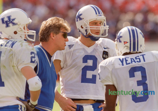 Kentucky coach Hal Mumme talked with quarter back Tim Couch (2), and wide receivers Lance Mickelsen (21) and Craig Yeast (3), during their game against  Penn State in the Outback Bowl in Tampa, Fla., Friday January 1, 1999. The Wildcats lost to the Nittany Lions 26-14. Kentucky takes on Georgia Tech today at 11am in the Taxslayer Bowl in Jacksonville, Florida. Photo by Charles Bertram | Staff