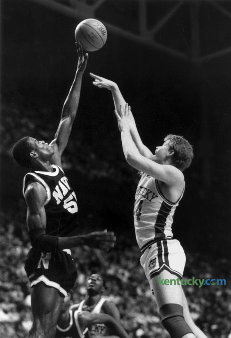 "Navy's David Robinson blocked a shot by Kentucky's Rob Lock Jan. 25, 1987 at Rupp Arena. Robinson finished the game with 45 points and 10 blocks, both a Rupp Arena records. He also had 14 rebounds, giving him  the only triple-double by a men's college player in Rupp history. He was so good that the opposing team, Kentucky, its coach, Eddie Sutton, and ABC analyst Dick Vitale gave him a standing ovation when he exited the game. The 7-foot-1 center blocked layup attempts — and even a three-pointer — and scored 12 of Navy's first 14 points and 19 of the first 23. Ten of those points came on dunks. The halftime score was UK 40, Robinson 21. ""He's the best I've ever played against,"" Lock said. ""I thought I was a pretty good defensive player, but I couldn't defend him at all. I was lucky he scored only 45 points."" Herald-Leader archive photo"