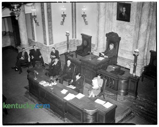 """The Kentucky legislature's chamber at the state capitol in Frankfort, during the 1940 General Assembly. During the 60-day session, lawmakers sent 206 bills and resolutions to the desk of Gov. Keen Johnson. He signed 76 of them into law, including the """"fair trade"""" liquor act which provides minimum markups of liquor and wine on sales by by wholesalers and retailers. Also made into law were measures intended to make banks """"safer"""" and more efficient for both the investing public and Kentucky's 318 state banks and 120 building and loan associations. And on the last day, during the last hours of the session, lawmakers approved the use of voting machines during elections. Among the vetoed measures was was a much-criticized proposal to tax coin or token-operated vending machines. Herald-Leader archive photo"""