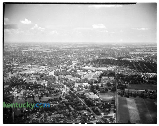 Aerial picture of the University of Kentucky campus during the 1945-46 school year. Downtown Lexington visible in background. South Limestone is seen running diagonally up from the bottom of the photo, while Rose Street moves vertically up the image. In between the two streets on campus is Memorial Hall, and Stoll Field. Directly behind Stoll Field is the future site of Memorial Coliseum, which started to be built shorty after this picture. Further in the background, at about exactly the middle of the image, is downtown Lexington, featuring  Lexington's first skyscraper, the First National Building. Herald-Leader archive photo